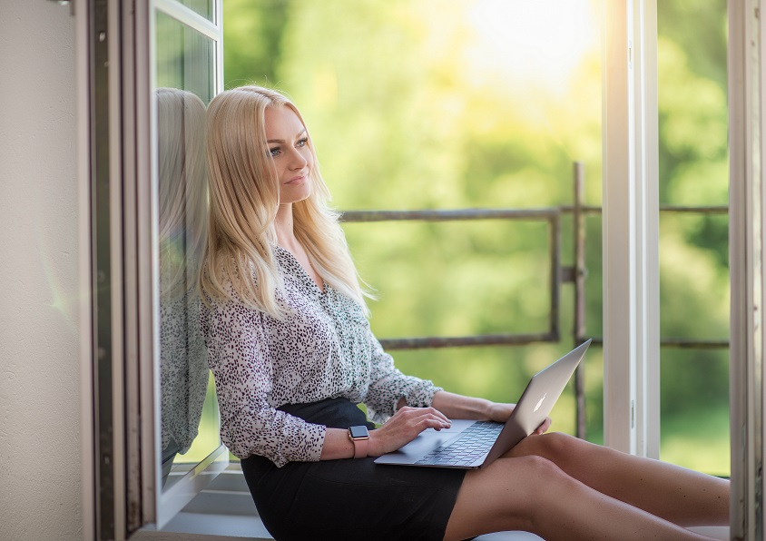 Therapist working on marketing her business and learning marketing truths about directory listings