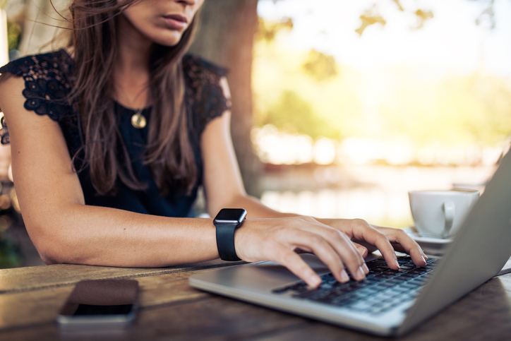 Woman developing her writer's mindset to grow her business.